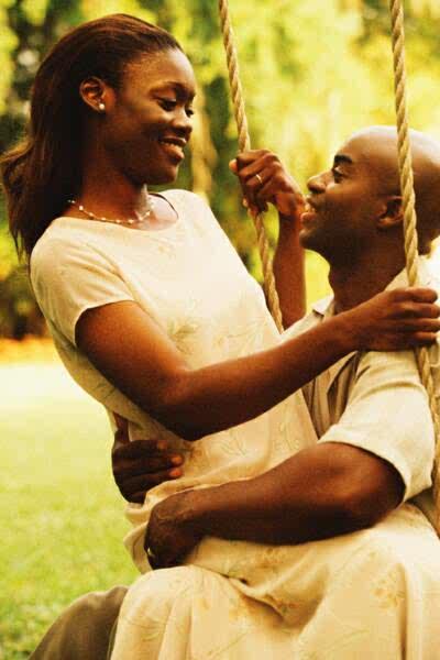black couple in swing